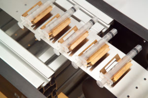 medical syringes being manufactured